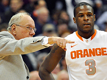 Syracuse coach Jim Boeheim gives Dion Waiters (12 points) instructions during the Orange's 78-55 win, Boeheim's 875th victory. (AP)