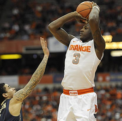 Dion Waiters makes an assist and a 3-pointer during a crucial juncture to help Syracuse achieve its first 20-0 start.  (US Presswire)