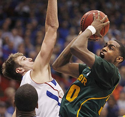 Kansas junior center Jeff Withey (10 rebounds, three blocks) consistently frustrates Quincy Miller and the Baylor front line.  (AP)