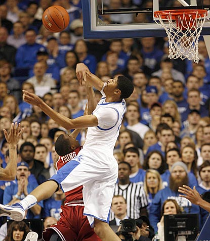 Anthony Davis rules the air on this night. Here, he swats away a shot by Arkansas guard B.J. Young.  (US Presswire)