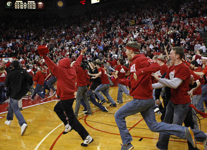 Nebraska fans storm the court after the Huskers beat the Hoosiers for their biggest victory as a new member of the Big Ten. (AP)