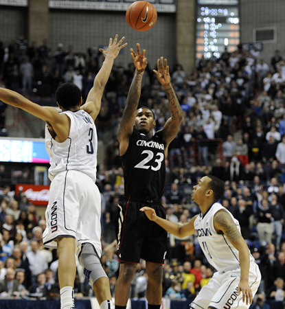 Cincy's Sean Kilpatrick connects from downtown with 2.7 seconds left and finishes with 16 points to help edge UConn. (AP)