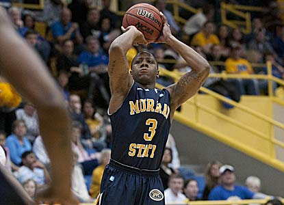 Isaiah Canaan scores 20 points to help Murray State escape OVC tourney champ Morehead St. and remain one of two unbeatens. (AP)