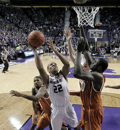Rodney McGruder scores a career high 33 points to lead K-State over a scrappy Texas team. (AP)