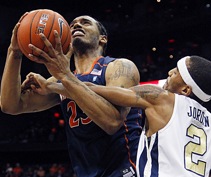 Virginia's Mike Scott scores 18 points, while fighting the Yellow Jackets for seven rebounds. (AP)