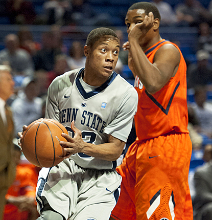 Tim Frazier gets around the Fighting Illini for 12 points, including the winning shot. (AP)