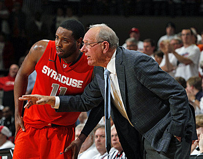 Jim Boeheim (right) notches his 877th win, putting him into sole possession of fourth place on the Division I coaching list. (US Presswire)