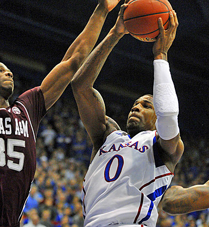 Kansas' Thomas Robinson (right) scores 16 of his 18 points in the second half to help the Jayhawks top Texas A&M. (US Presswire)