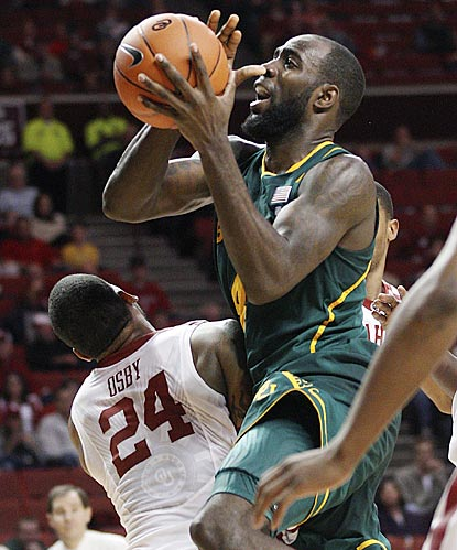Baylor forward Quincy Acy collides with Oklahoma forward Romero Osby (24) as he goes up for a shot in the second half.  (AP)