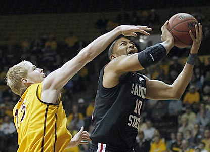 Despite an extended journey to Laramie, Tim Shelton and San Diego State muster the effort to get past Adam Waddell and Wyoming. (AP)