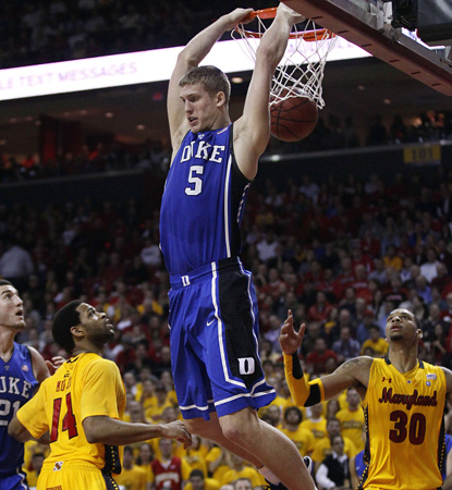 Mason Plumlee dunks here for two of his 23 points and adds 12 boards to help Duke beat Maryland. (AP)