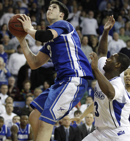 Creighton superstar Doug McDermott carries his team with 30 points in a road win over Drake. (AP)