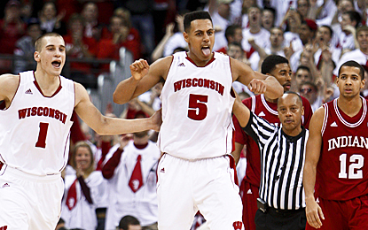 Ryan Evans (center) celebrates during the final seconds as the Badgers beat the Hoosiers. (AP)