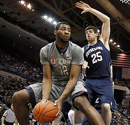 Andre Drummond works the paint against the Irish, tallying 15 points and 11 boards in UConn's loss. (US Presswire)