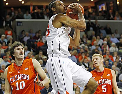 Mike Scott carries Virginia with 23 points, including four free throws over the final 16.8 seconds to help hold off Clemson. (US Presswire)