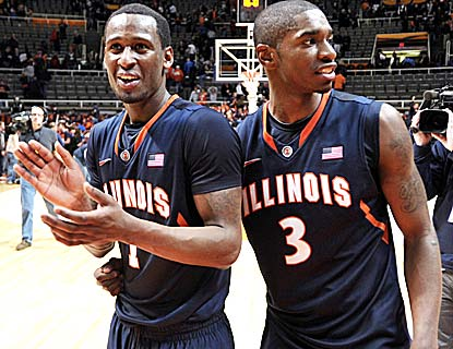 D.J. Richardson and Brandon Paul enjoy Illinois' win, one in which Michigan St. loses its best player in Draymond Green.  (AP)