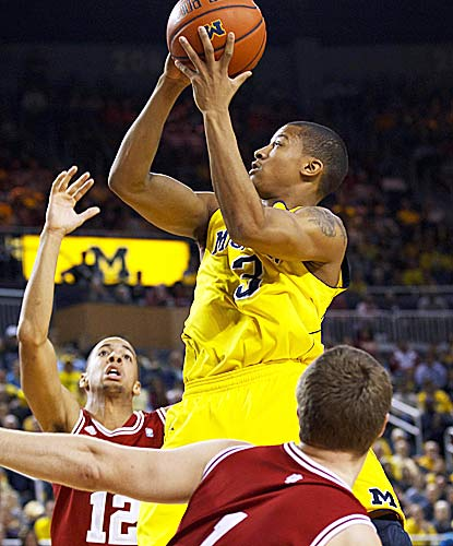 Trey Burke goes 5 for 9 from the field for 18 points as the Wolverines stay unbeaten at home. (US Presswire)