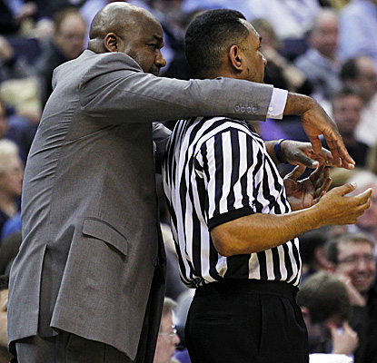 Coach John Thompson III demonstrates what he believes a foul looks like as No. 14 Georgetown clamps down on South Florida. (US Presswire)