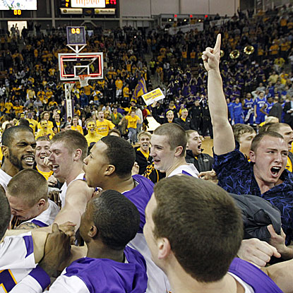Northern Iowa fans storm the court following Anthony James' buzzer-beating basket to defeat No. 13 Creighton.  (AP)