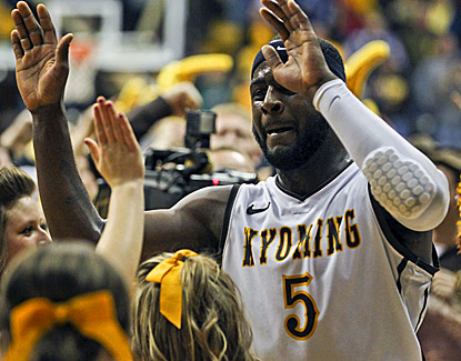 Wyoming's Leonard Washington, celebrating with fans, scores 16 points to help the Cowboys knock off No. 11 UNLV. (US Presswire)