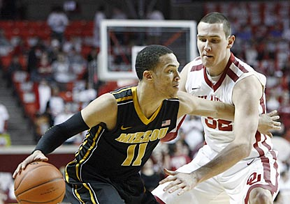 Missouri guard Michael Dixon, who winds up with 13 points, attempts to get past Casey Arent in the first half.  (AP)