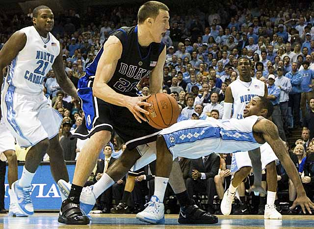 Senior Miles Plumlee and his brother Mason, a junior, made Duke a part of their family. (Getty Images)