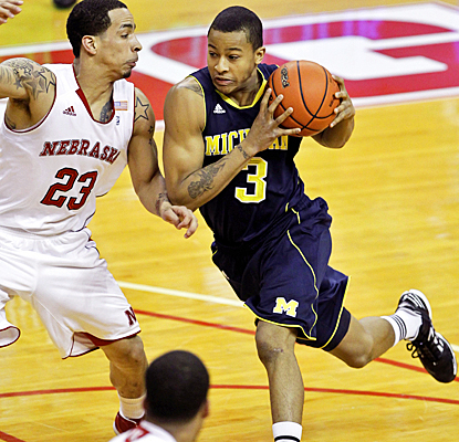 Michigan's Trey Burke drives past the Cornhuskers for 12 points, five rebounds and five assists. (AP)