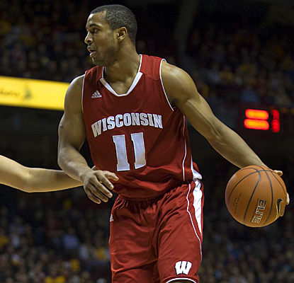 Jordan Taylor gives his all for Wisconsin, scoring 27 points against the Golden Gophers. (US Presswire)