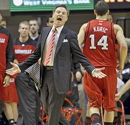 Rick Pitino gives the officials a piece of his mind; Kyle Kuric helps calm his coach with 17 points to rally Louisville.  (AP)