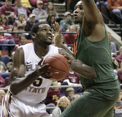 Florida State big man Bernard James goes 7 for 8 in the second half to tie his career high of 18 points.  (AP)