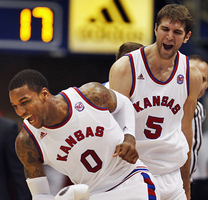 Thomas Robinson and Jeff Withey do most of the damage against Oklahoma State as they combine for 42 points and 34 boards. (AP)