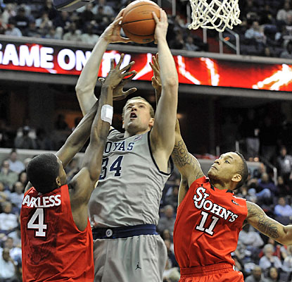 Nate Lubick fills up the stat sheet for Georgetown with seven points, eight rebounds, five assists and four blocks.  (AP)