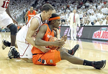 C.J. Fair (right) and Syracuse earn the decision against Kyle Kuric and Louisville in a Big East wrestling match.  (Getty Images)