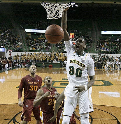 Baylor's Quincy Miller gets two of his 16 points the easy way while Tyrus McGee (25) and Royce White (30) can only watch.  (AP)