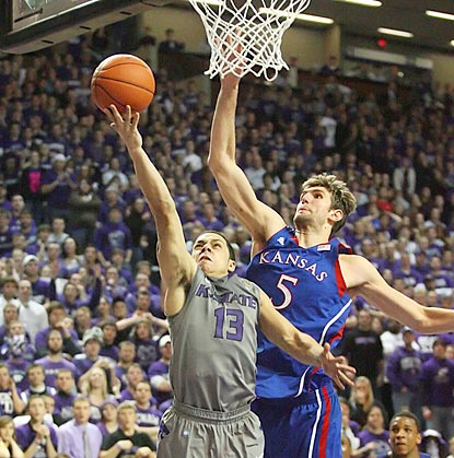 With Kansas up four in the final minute, Jayhawks center Jeff Withey (5) swoops in to block Angel Rodriguez's layup attempt.  (US Presswire)