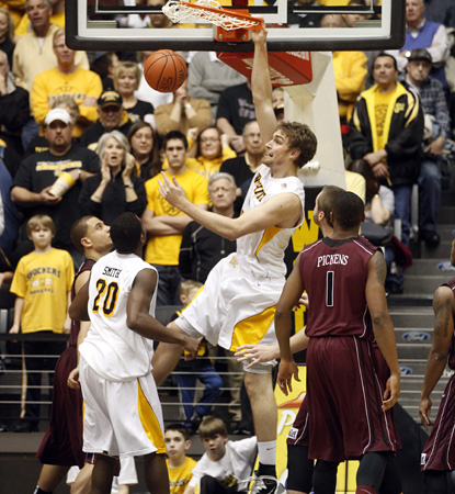 Shockers' big man Garrett Stutz dunks here for two, but he does most of his damage from outside, hitting four treys. (AP)