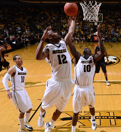 Missouri's Marcus Denmon (No. 12) leads the Tigers in a revenge game with 17 points against Oklahoma State. (AP)