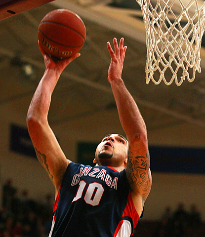 Gonzaga's Robert Sacre goes up for a basket, scoring two of his 20 points against Santa Clara. (AP)