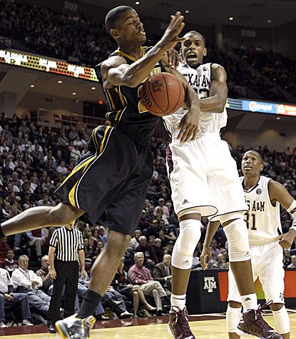 Missouri's Kim English (left) battles with Texas A&M's Khris Middleton. English scores 21 points in the Tigers' 71-62 win. (AP)
