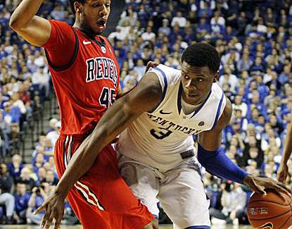 Kentucky's Terrence Jones (right), who scores 15 points and grabs 11 rebouds, drives past Mississippi's Jelan Kendrick. (AP)