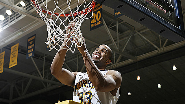 Jewuan Long cuts down the net, celebrating the Racers' Ohio Valley Conference title. (US Presswire)
