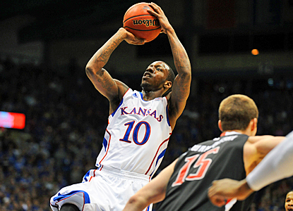 Tyshawn Taylor of the No. 4 Jayhawks takes a shot during the first half against the Red Raiders. (US Presswire)