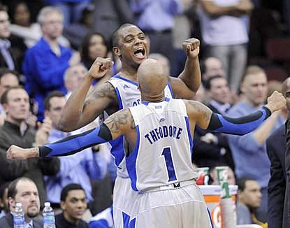 Herb Pope celebrates with Jordan Theodore (1) as a crucial victory winds down for host Seton Hall.  (AP)