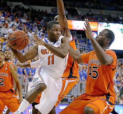 Erving Walker, who winds up with a game-high five assists, looks for a teammate around Auburn forward Adrian Forbes (45).  (AP)