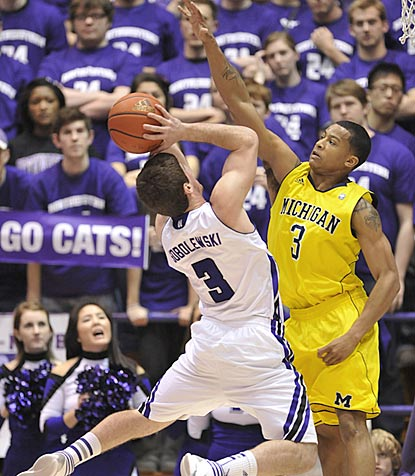 Northwestern's Dave Sobolewski tries to shoot over Michigan guard Trey Burke in the second half.  (AP)