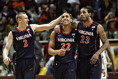 Paul Jesperson (2) and Mike Scott (23) congratulate guard Malcolm Brogdon (22) for his clinching steal in the final seconds.  (US Presswire)