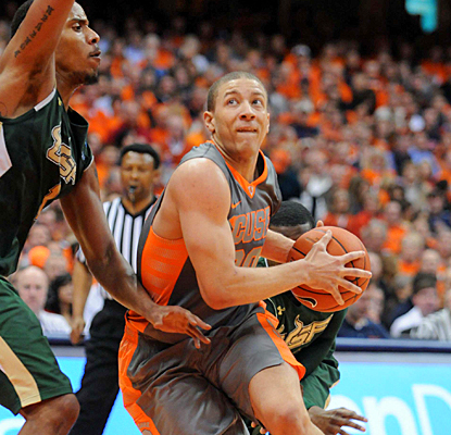 Syracuse's Brandon Triche drives past South Florida's Ron Anderson Jr. during the second half.  (US Presswire)