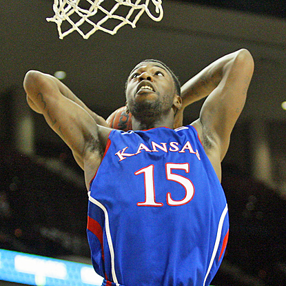 Kansas' Elijah Johnson dunks for two of his team-high 21 points against Texas A&M. (US Presswire)