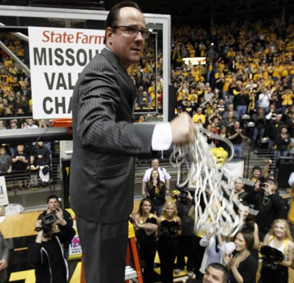 Wichita State coach Gregg Marshall cuts down the nets in celebration of the Missouri Valley Conference regular season title.  (AP)