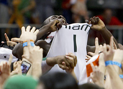 Durand Scott celebrates with fans after Miami beats FSU to help its chances at earning a NCAA tournament bid. (AP)